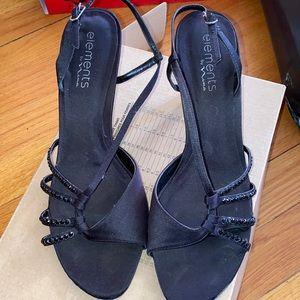 Simple, small black heels